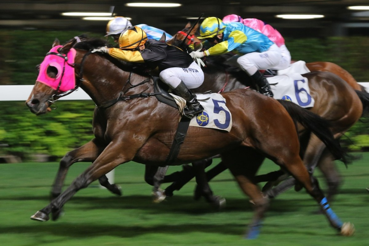 Keith Yeung drives Top Score to victory at Happy Valley in April. Photos: Kenneth Chan