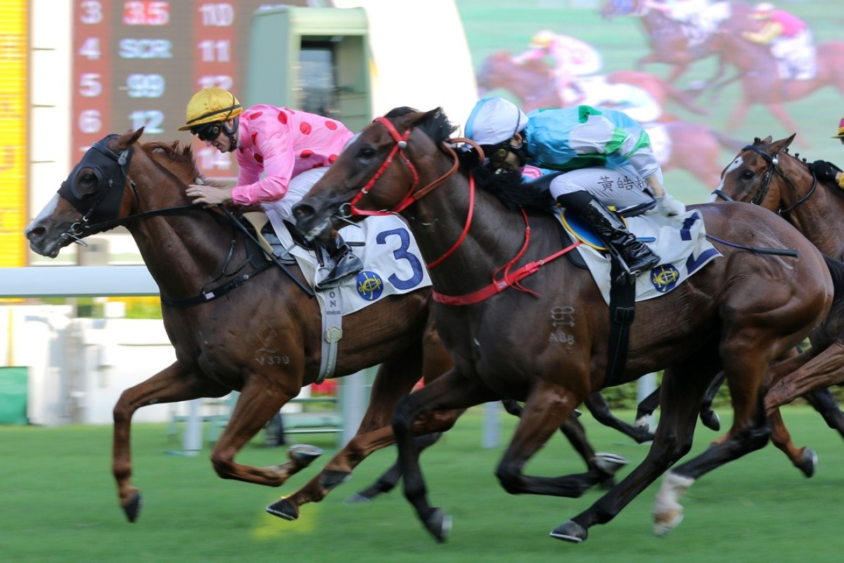 Zac Purton pilots Starship to the line to finally take the jockeys' championship lead from arch-rival Joao Moreira at Sha Tin on Sunday. Photos: Kenneth Chan