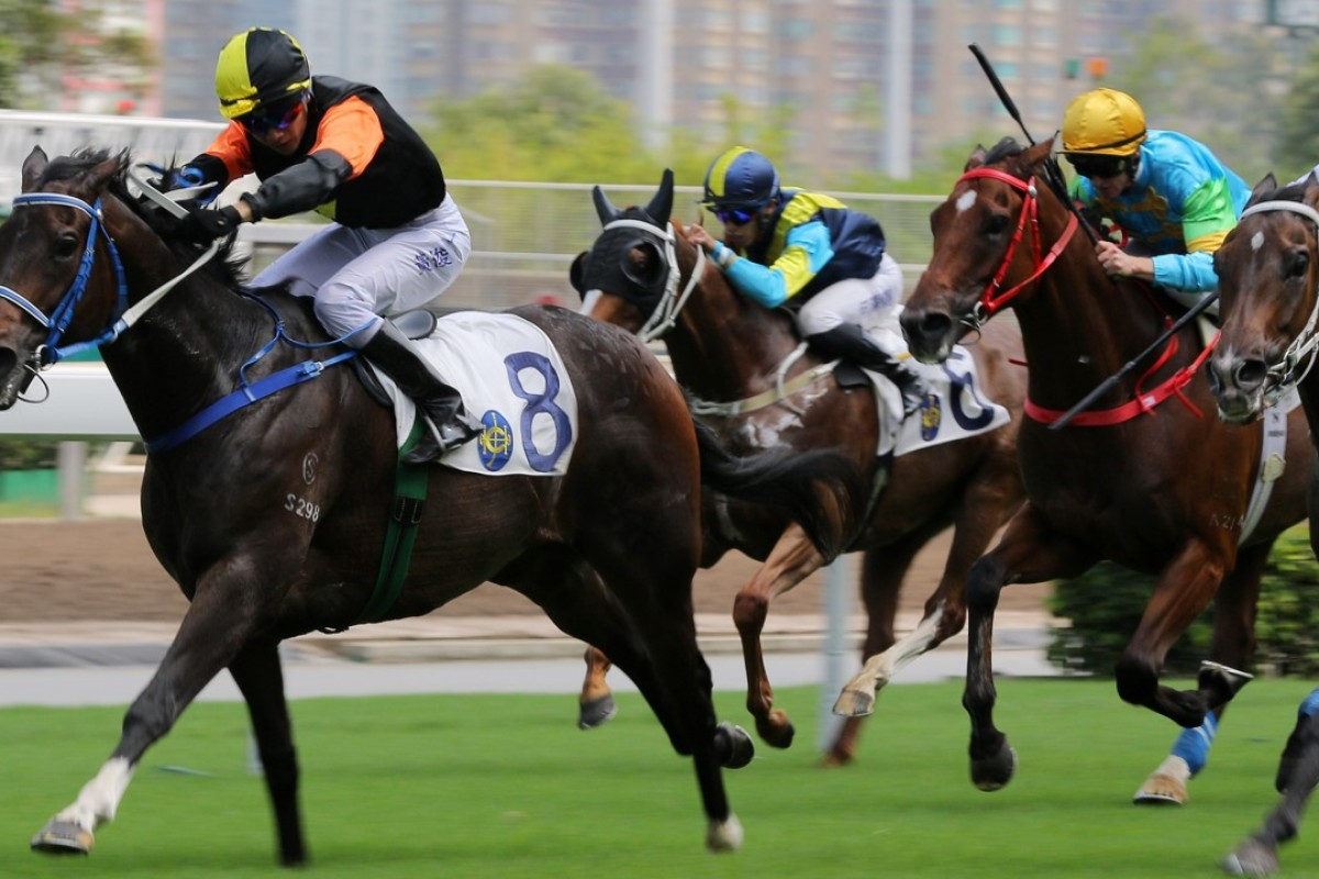 Apprentice jockey Victor Wong guides Pikachu over the line at Sha Tin on Sunday. Photos: Kenneth Chan