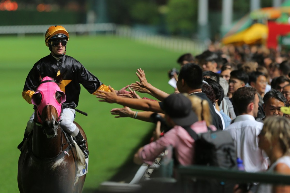 Zac Purton high fives fans after Top Score's win at Happy Valley. Photos: Kenneth Chan.