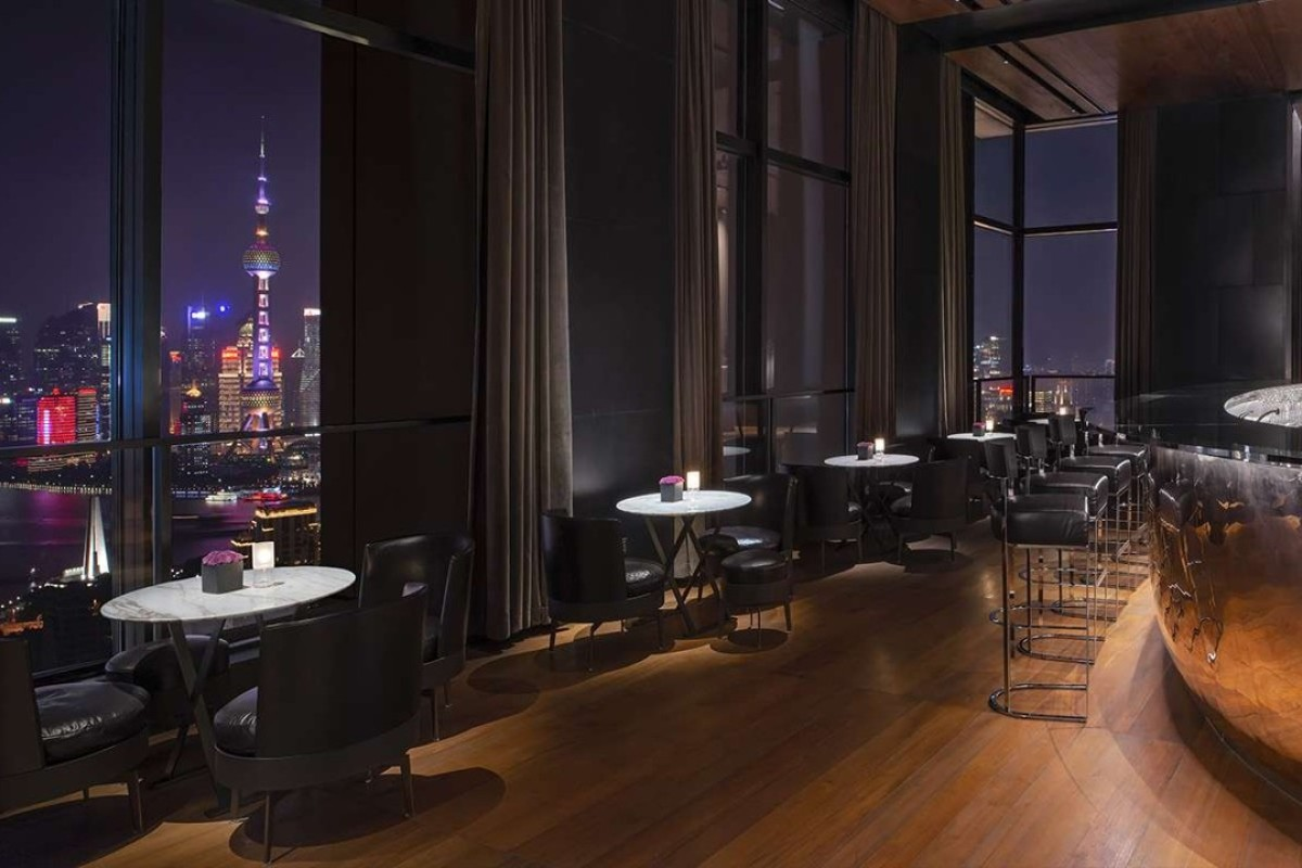 Il Bar in the new Bulgari Hotel Shanghai, China is a sleek space of polished wood and black leather furnishings.