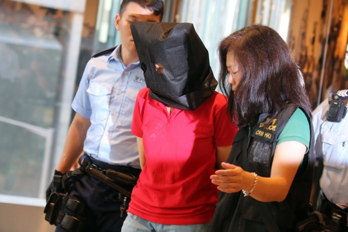 Ada Tsim Sum-kit (centre), the 44-year-old female bodyguard who allegedly shot dead an elderly aunt and uncle at Quarry Bay Park last month. Picture: Dickson Lee.