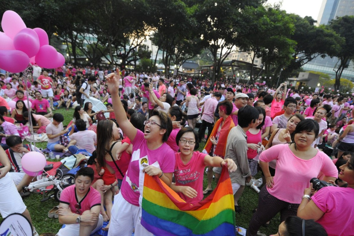 Two women cheer at a Pink Dot rally in support of gay rights in Singapore. Photo: AP