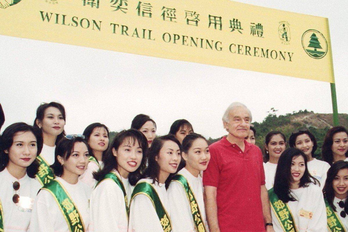 David Wilson poses for a picture with the contestants in the Miss Chinese International beauty pageant during the opening ceremony of the Wilson Trail at the Kam Shan Country Park. Photo: SCMP Pictures