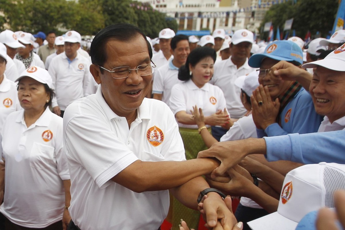 Cambodian Prime Minister Hun Sen greets supporters in Phnom Penh. Photo: AP
