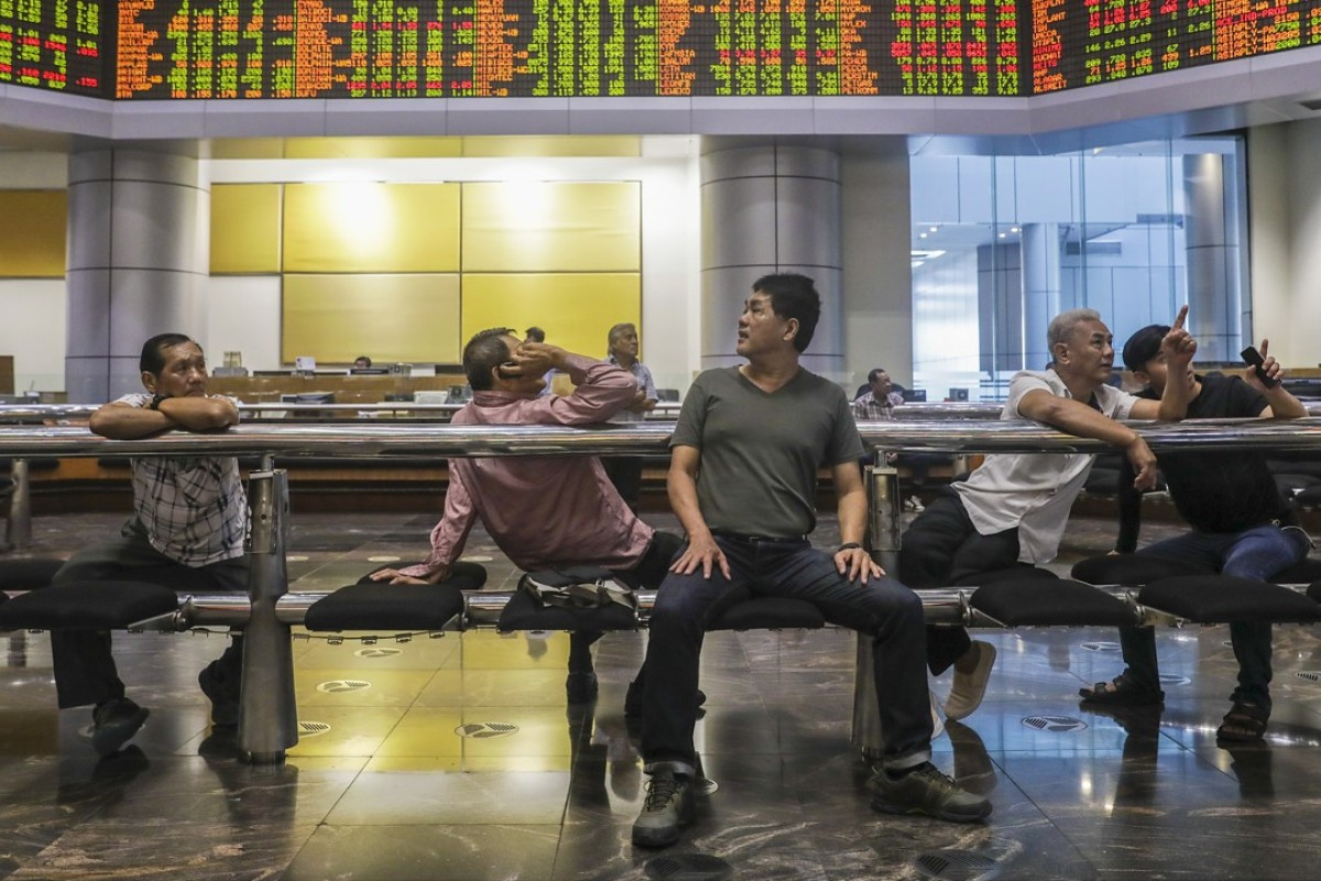Investors at a private stock market gallery in Kuala Lumpur, Malaysia. Photo: EPA