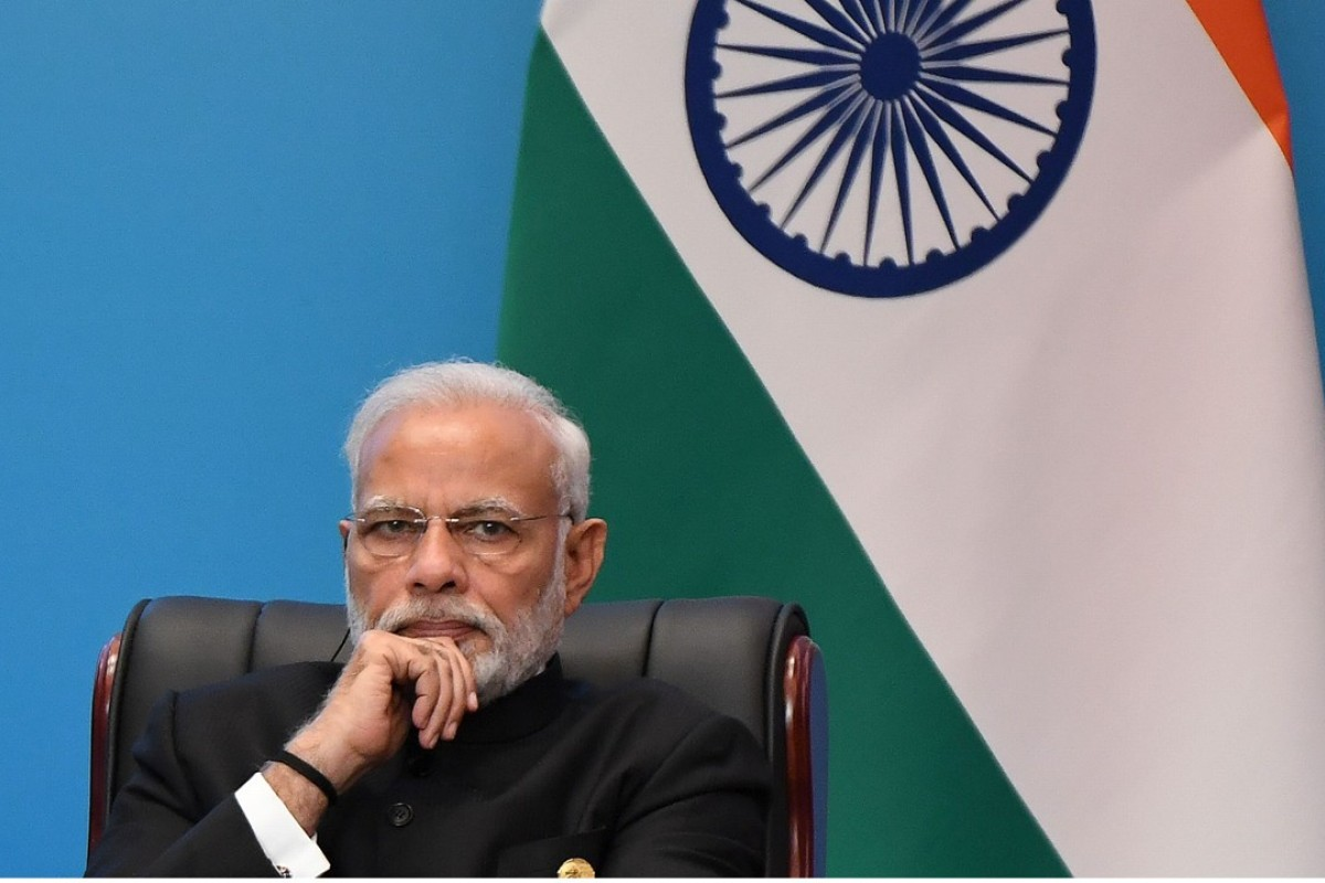 Indian Prime Minister Narendra Modi looks on as he attends a signing ceremony during the Shanghai Cooperation Organisation (SCO) Summit in Qingdao, China. His ruling government has come under fire for a crackdown on dissent following the arrest of key rights activists. Photo: AFP