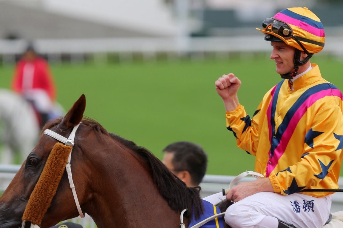 Zac Purton celebrates his win aboard Winner's Way on Sunday. Photos: Kenneth Chan