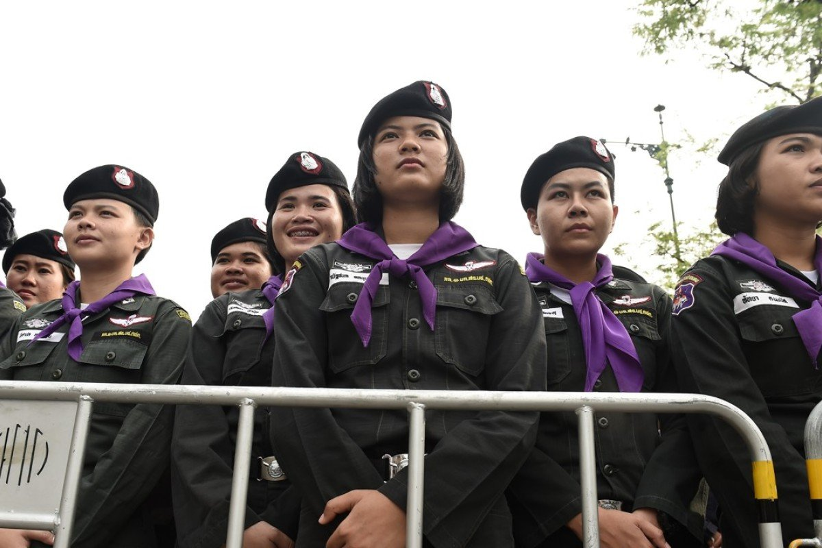 A phalanx of Thai police women at Thammasat University during a protest to mark the fourth year of junta rule in Bangkok on May 22. A key police training academy has banned female cadets. Photo: AFP