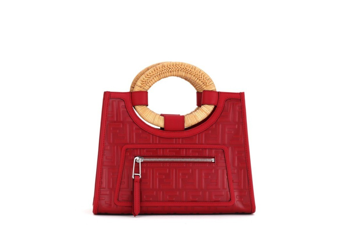 Fendi. The Mini Runaway bag in red calfskin has raised FF motifs over the entire surface and a rigid oval double handle in woven rattan, HK$19,800