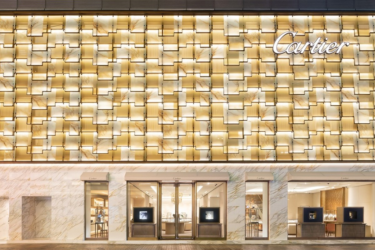 "The new exterior of Cartier's expanded boutique is inspired by roof tiles typically used for traditional houses. The 'tiled"" façade, made with onyx, bronze and calacata, brings to life a modern look with a touch of femininity."