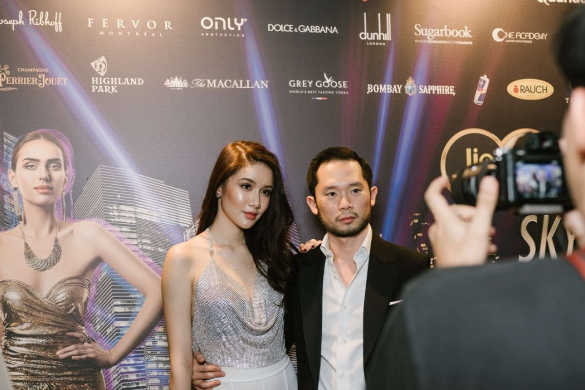 Darren Chan, the Sugarbook founder, and his girlfriend Charmaine at The Fast Lane party. Chan was inspired to create Sugarbook as his friends often teased Charmaine, who is 10 years younger than him. Photo: Resty Woro Yuniar