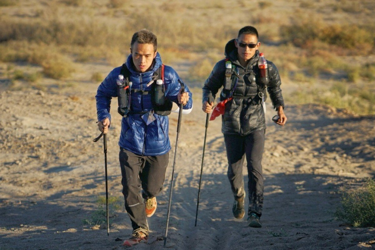 Liang Jing (left) and Zhou Jiaju battle it out at the Ultra Gobi 400km race. Photo: Lloyd Belcher Visuals