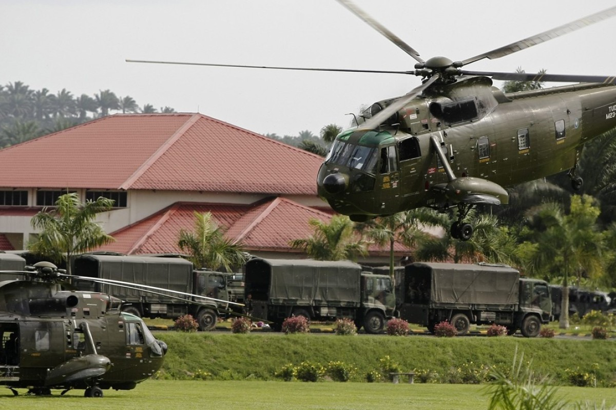 Malaysian army helicopters and vehicles at the temporary army base camp at Felda Sahabat near Lahad Datu. Photo: EPA