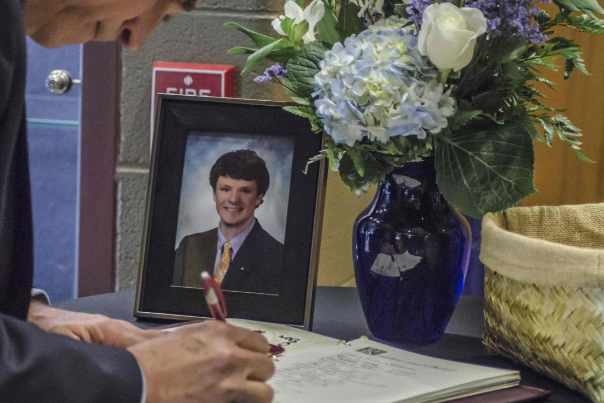 A mourner signs a guestbook during Otto Warmbier's funeral. Picture: AFP