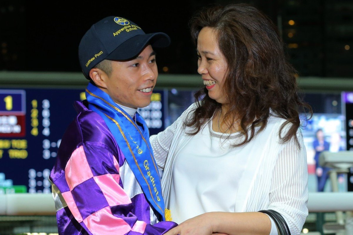 Matthew Poon is congratulated by his mother after collecting his 70th winner and graduating from the Apprentice Jockeys' School. Photos: Kenneth Chan