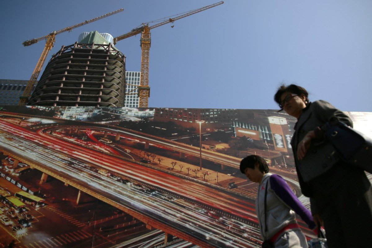 China's economy is slowing as the trade war begins to bite. Photo: EPA