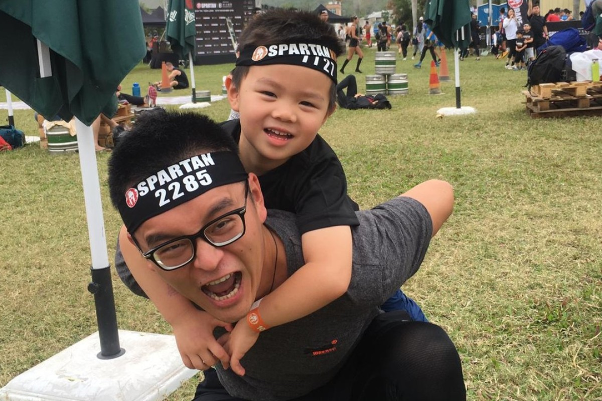 Tommy Liu and his son Skylar preparing for the kids race. Tommy hopes his son will develop a never-give-up attitude. Photos: Mark Agnew
