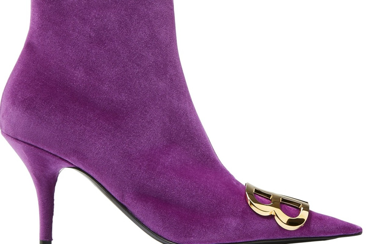 Balenciaga. This velvet ankle boot features a pointed toe, a kitten heel and a gold metallic double B logo at the front, HK$13,700