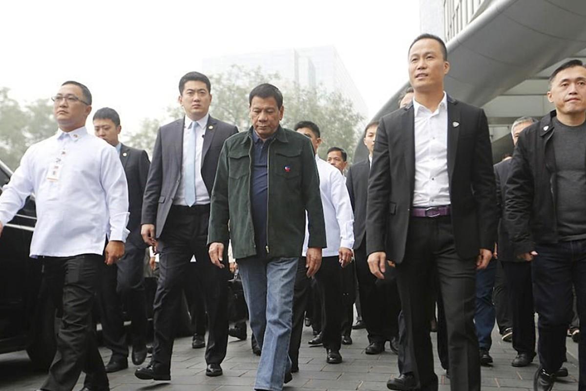 President Rodrigo Duterte accompanied by businessman Michael Yang (second right) in Beijing. Photo: Reuters