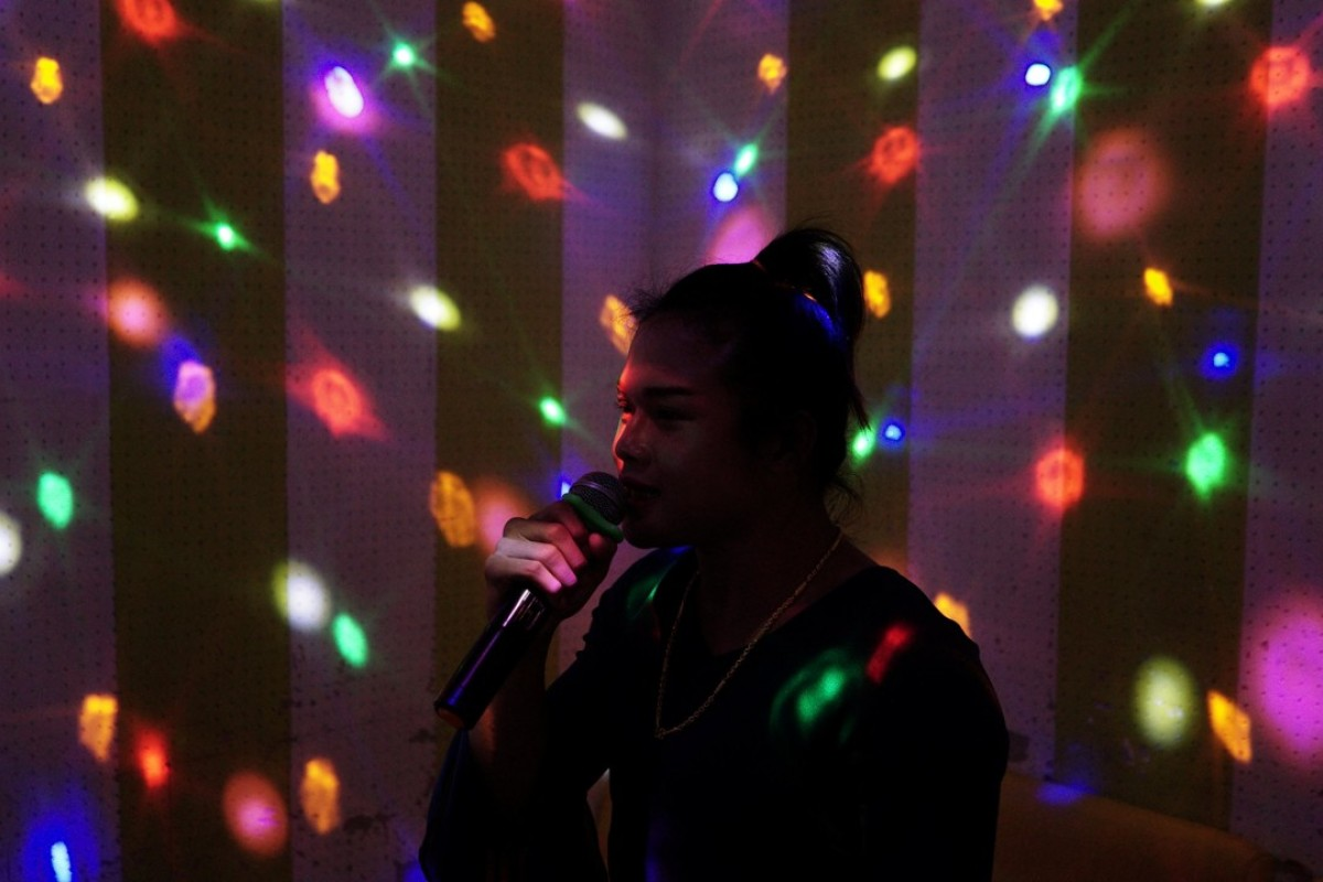 A transgender Muay Thai boxer at a karaoke room in Thailand. Photo: Reuters