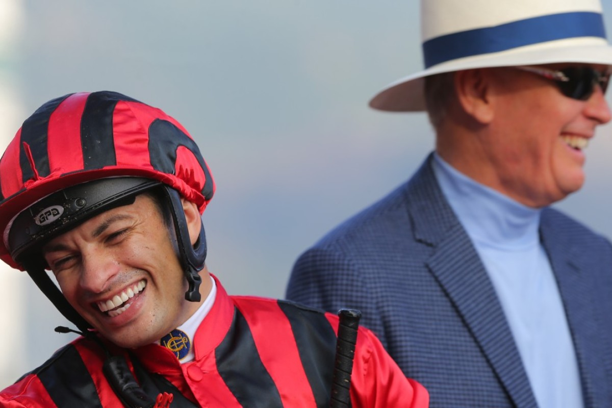 Jockey Silvestre de Sousa and trainer John Moore share a laugh after combining for a winner last week. Photos: Kenneth Chan