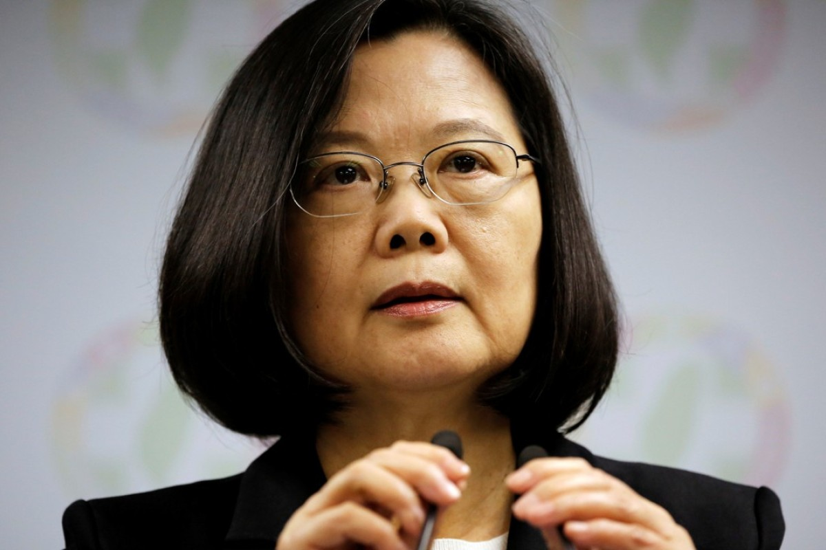 President Tsai Ing-wen announces her resignation as chairwoman of the Democratic Progressive Party after Taiwan's elections. Photo: Reuters