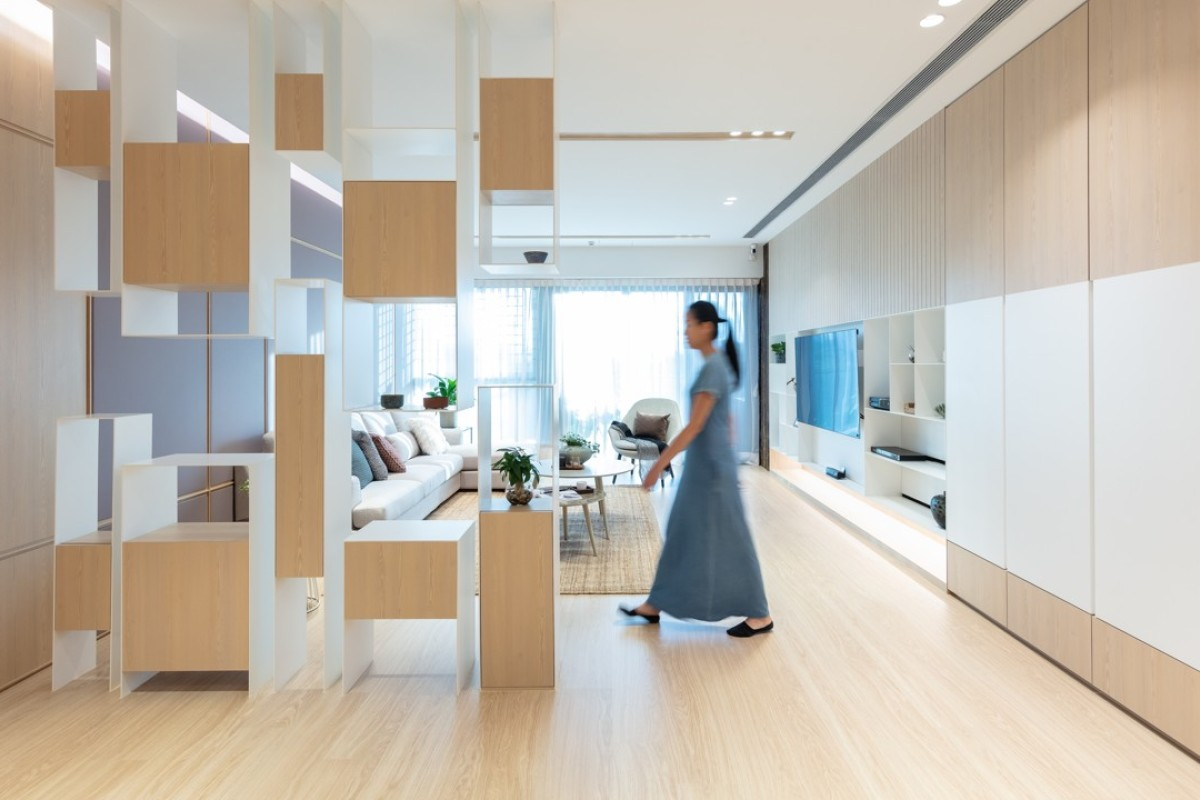 The living area of this Kowloon Tong flat by Max Lam Designs features a unique divider, which seemingly floats in the centre of the room, providing storage and helping to divide the space. Photography: Dick Liu