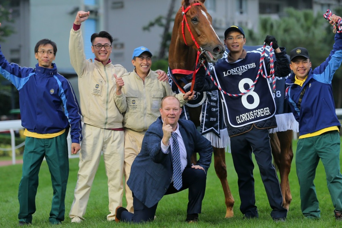Australian Kelly Doobs poses with Glorious Forever and trainer Frankie Lor's staff at Sha Tin last Sunday. Photo: Kenneth Chan