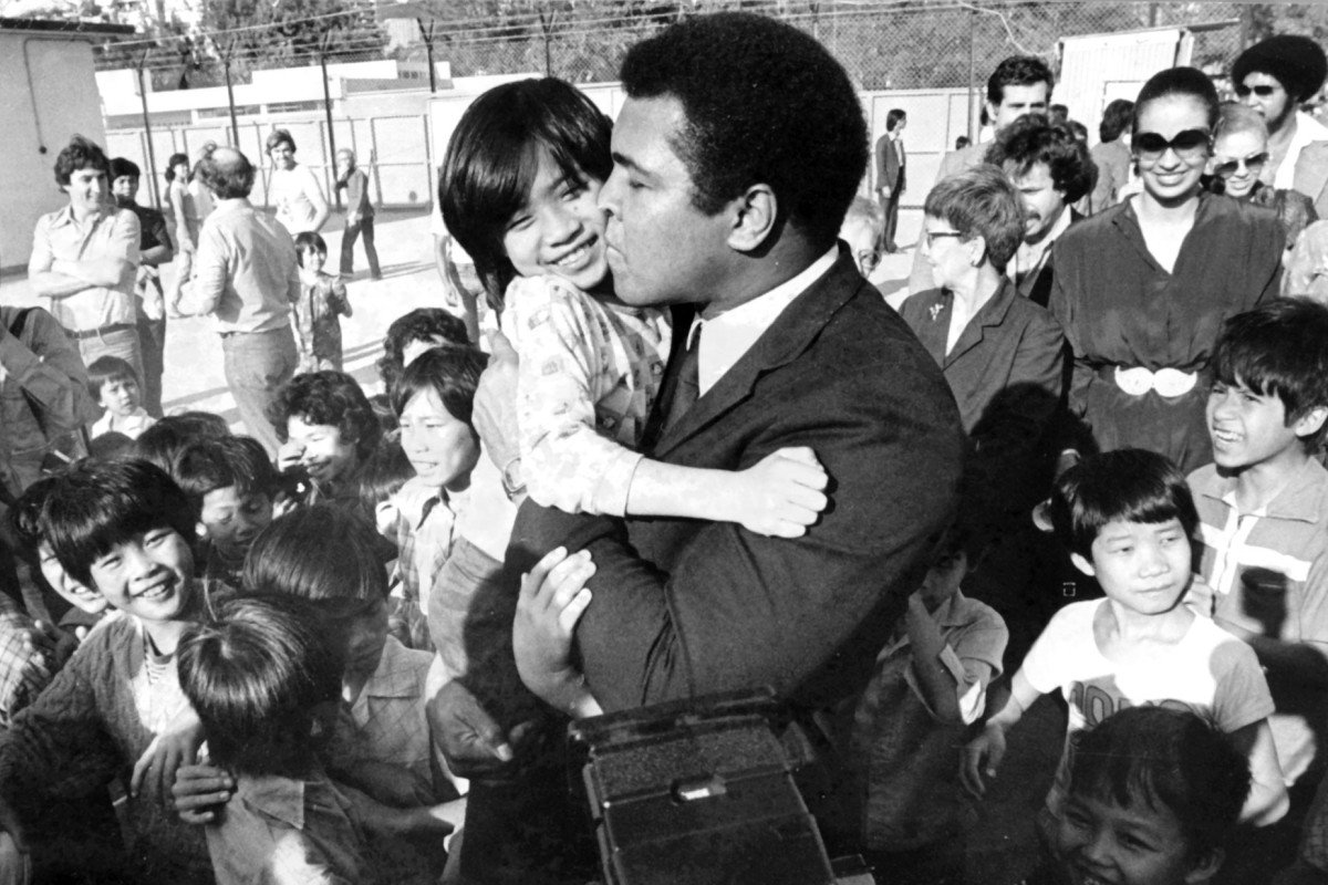 Muhammad Ali visits the Kai Tak East Refugee Transit Centre on December 22,  1979.