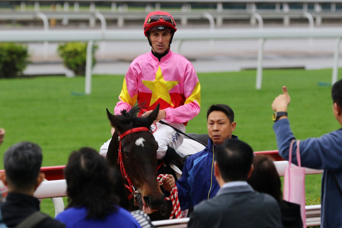 Tye Angland returns to scale after riding Follow Me to victory at Sha Tin on November 25. Photos: Kenneth Chan