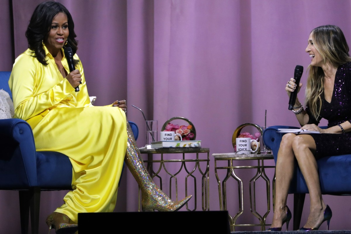 Former US first lady Michelle Obama (left) wears a pair of eye-catching, over-the-knee Balenciaga boots while chatting about her new book, 'Becoming: An Intimate Conversation with Michelle Obama', at a book promotion event in New York last week. Photo: AP