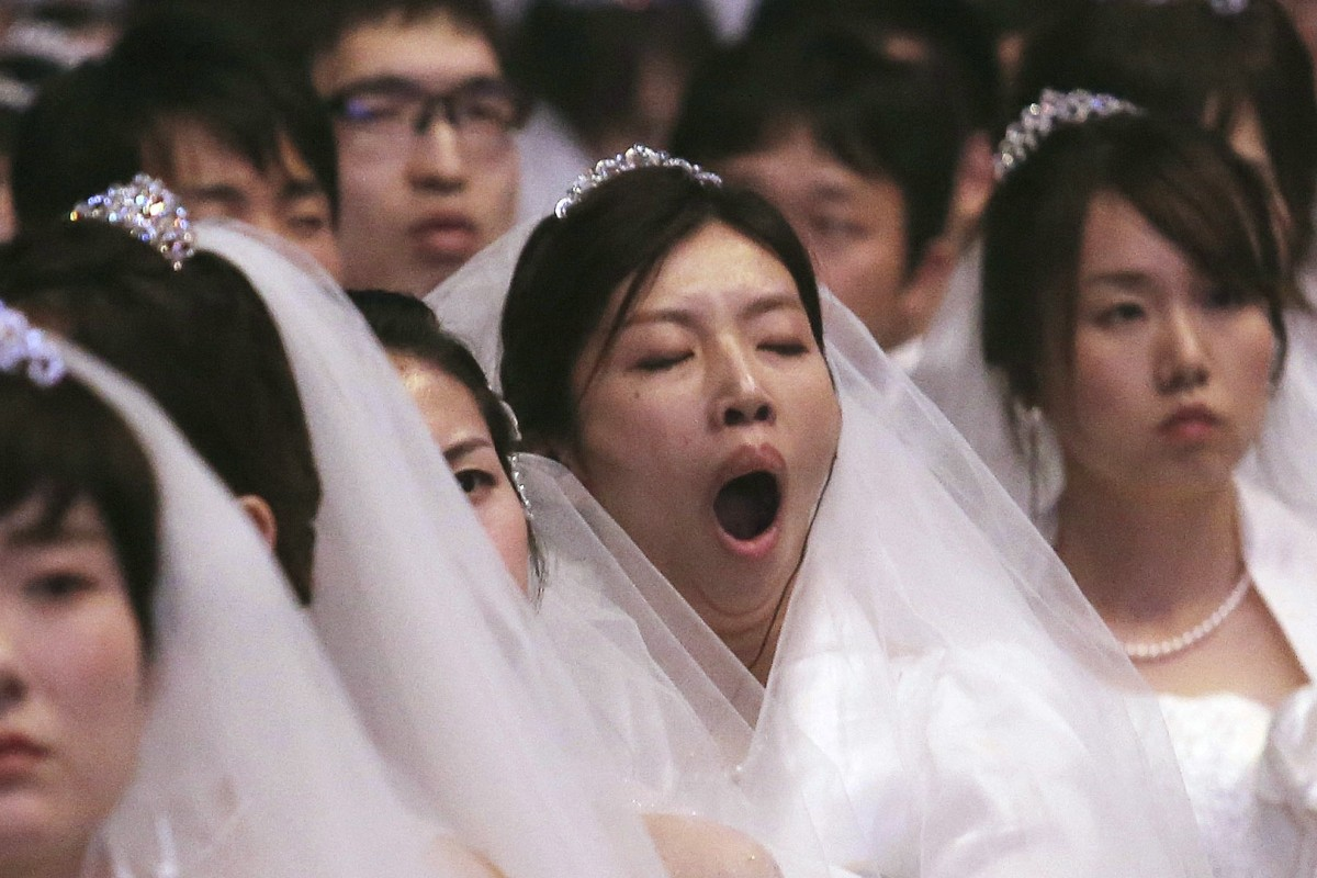 A bride yawns during a mass wedding held in Gapyeong, South Korea, in August. Photo: AP