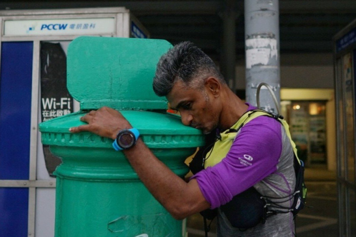 Abimanyu Shunmugam kisses the postbox, marking his successful survival last year before almost immediately deciding to return for another crack. Photo: Lloyd Belcher
