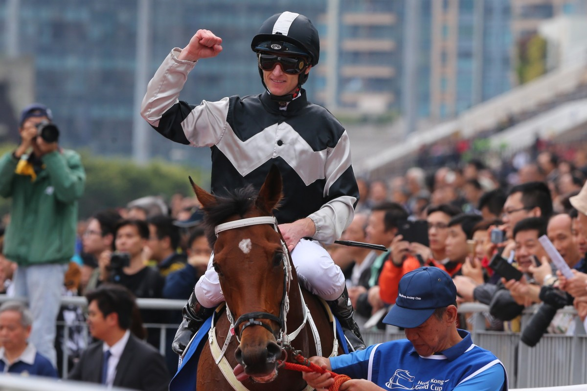 Zac Purton celebrates his win aboard Exultant. Photos: Kenneth Chan