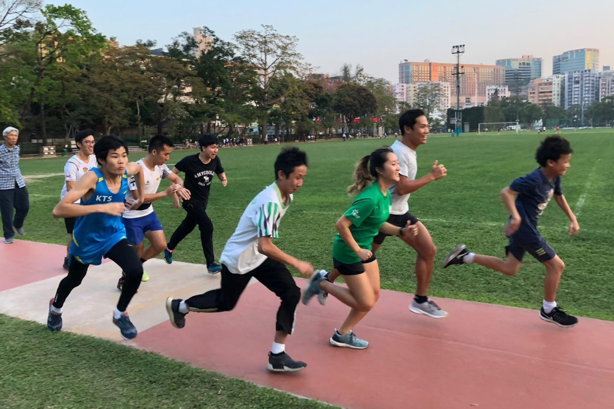 Wong Ho-chong runs with his class of troubled teenagers, he helps them find purpose with sport. Photos: Handout