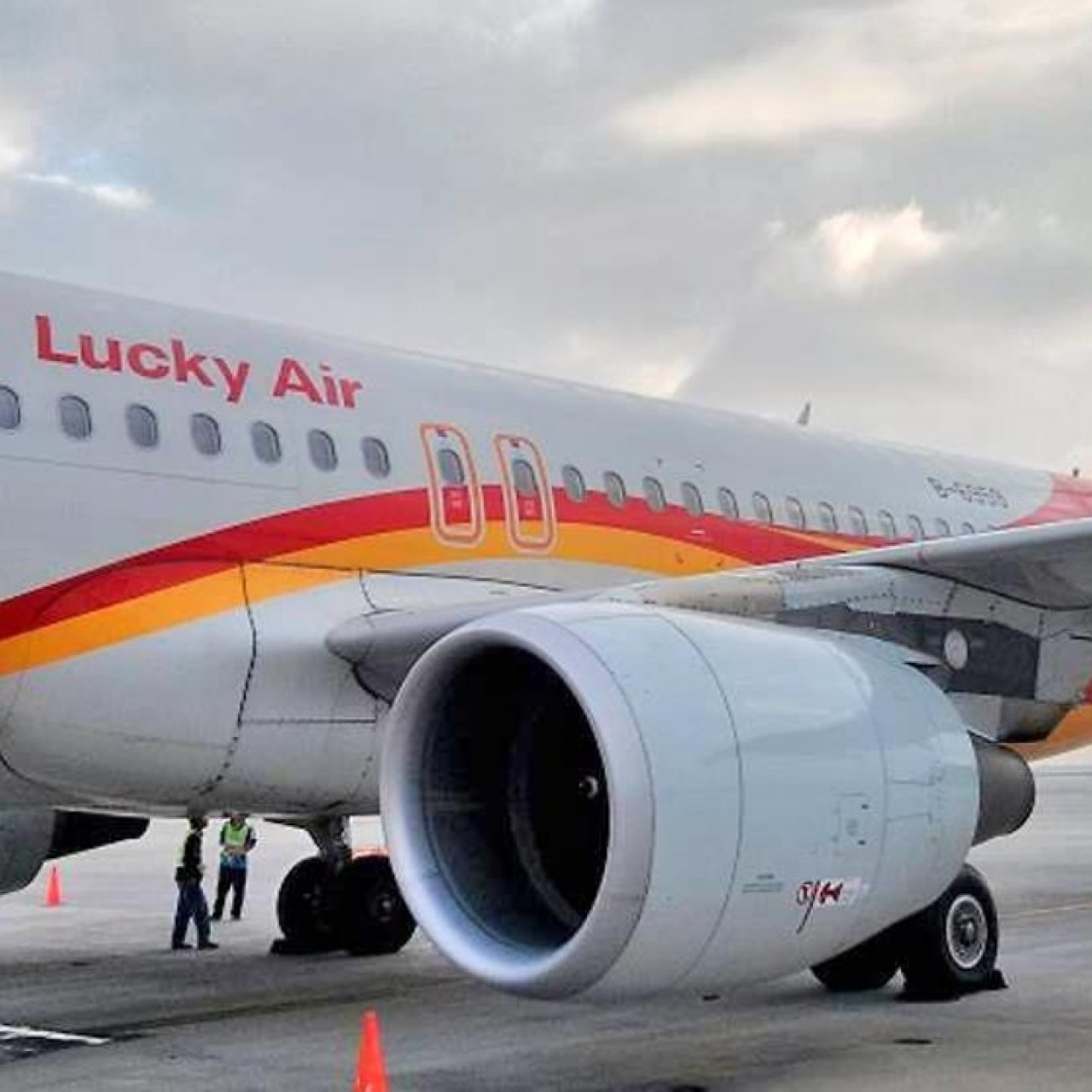 Another elderly Chinese passenger tosses coins into plane engine